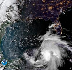 This satellite image provided by the National Oceanic and Atmospheric Administration shows a view of Tropical Storm Michael, lower right, churning as it heads toward the Florida Panhandle.