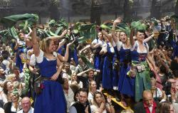 Waitresses dance in the Hofbraeu tent after the closing of the Oktoberfest beer festival in Munich.