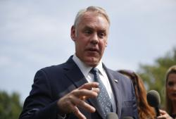 In this Aug. 16, 2018, file photo, Interior Secretary Ryan Zinke speaks to members of the media outside the White House in Washington, D.C.