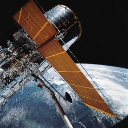 In this April 25, 1990 file photo provided by NASA, most of the giant Hubble Space Telescope can be seen as it is suspended in space by Discovery's Remote Manipulator System (RMS) following the deployment of part of its solar panels and antennae