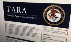 In this Aug. 18, 2016, file photo, a portion of the website for the website fara.gov, on the Foreign Agents Registration Act, is seen photographed in Washington