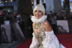 "Lady Gaga poses for photographers upon arrival at the premiere of the film ""A Star Is Born"" in London."