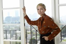 "This Sept. 27, 2018 photo shows Michelle Williams, a cast member in the film ""Venom,"" posing for a portrait at the Four Seasons Hotel in Los Angeles"