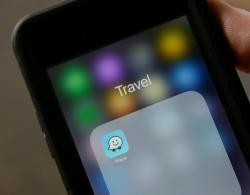 In this March 27, 2017, file photo, the Waze application is displayed on a smartphone in San Francisco