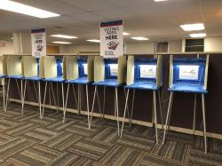 In this Sept. 20, 2018 photo, voting booths stand ready in downtown Minneapolis for the opening of early voting in Minnesota