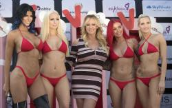 Adult film actress Stormy Daniels, 3rd left, attends the opening of the adult entertainment fair 'Venus' in Berlin, Germany.