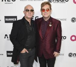 Elton John, right, and Bernie Taupin arrive at Elton John's 70th Birthday and 50-Year Songwriting Partnership with Taupin in Los Angeles.