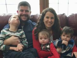 In this Dec. 10, 2017 photo provided by the family, Jon and Kari Kilquist sit with their children, from left, Will, Emmy and Owen at their home in Murphysboro, Ill.