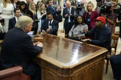Rapper Kanye West speaks during a meeting with President Donald Trump in the Oval Office of the White House.
