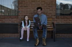 "Violet Mcgraw and Henry Thomas in a scene from ""The Haunting of Hill House."""