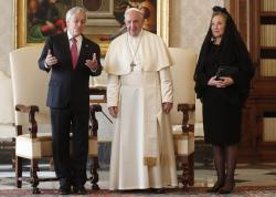 Pope Francis poses with Chile's President Sebastian Pinera and his wife Cecilia Morel during a private audience at the Vatican.