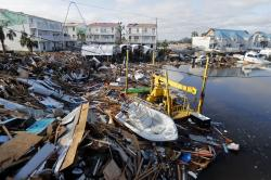 In this Oct. 11, 2018 file photo, a boat sits amidst debris in the aftermath of Hurricane Michael in Mexico Beach, Fla.