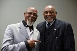 In this Sept. 28, 2016, file photo, John Carlos, left, and Tommie Smith pose for a portrait at Georgetown University in Washington