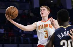 In this Oct. 1, 2018 file photo, Atlanta Hawks rookie guard Kevin Huerter (3) goes to the basket past the defense of New Orleans Pelicans forward Julius Randle during the second half of a preseason basketball game in Atlanta