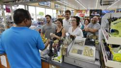 People line up at the Kwik Stop food store at 46th Ave and Hollywood Blvd, in Hollywood.