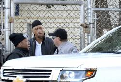 Former Carolina Panthers NFL football player Rae Carruth, center, exits the Sampson Correctional Institution in Clinton, N.C., Monday, Oct. 22, 2018