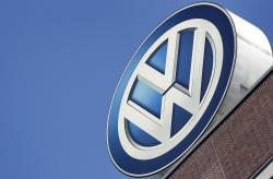 In this Wednesday, Aug. 1, 2018 file photo, the logo of Volkswagen is seen on top of a company building in Wolfsburg, Germany