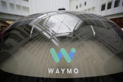 In this Dec. 13, 2016, file photo, a skylight is reflected in the rear window of a Waymo driverless car during a Google event in San Francisco