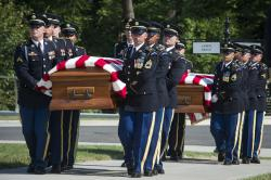 In this Sept. 6, 2018 photo, the 3rd Infantry Regiment, also known as the Old Guard, carry the remains of two unknown Civil War Union soldiers to their grave at Arlington National Cemetery in Arlington, Va.