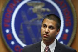 In this Dec. 14, 2017, file photo, Federal Communications Commission Chairman Ajit Pai arrives for an FCC meeting on net neutrality, in Washington