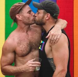 Actor Matt Wilkas, left, kisses his boyfriend Gus Kenworthy.