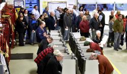 Voters wait on line to vote inside the fire bay at the Armada Twp. Fire Department, Tuesday , Nov. 6, 2018, in Armada Twp, Mich.