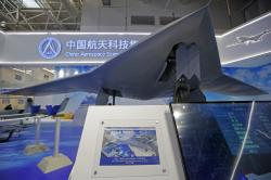 China's new-generation stealth unmanned combat aircraft prototype, the CH-7, is displayed during the 12th China International Aviation and Aerospace Exhibition, also known as Airshow China 2018, Tuesday, Nov. 6, 2018, in Zhuhai city, south China's Guangdong province