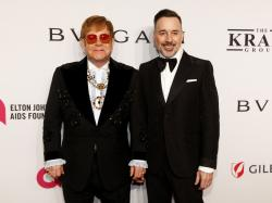 "Elton John, left, and David Furnish attend the Elton John AIDS Foundation's 17th annual ""An Enduring Vision"" benefit gala."