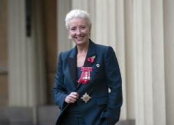 Emma Thompson stands outside Buckingham Palace, London, after being made a Dame Commander of the British Empire by Prince William.
