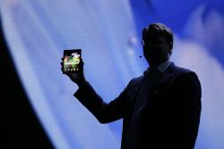 Justin Denison, SVP of Mobile Product Development, shows off the Infinity Flex Display of a folding smartphone during the keynote address of the Samsung Developer Conference Wednesday, Nov. 7, 2018, in San Francisco