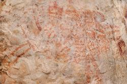 """This composite image from the book """"Borneo, Memory of the Caves"""" shows the world's oldest figurative artwork dated to a minimum of 40,000 years, in a limestone cave in the Indonesian part of the island of Borneo"""