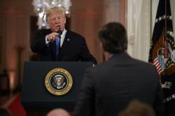 President Donald Trump speaks to CNN journalist Jim Acosta during a news conference in the East Room of the White House.