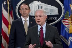 Attorney General Jeff Sessions accompanied by Deputy Attorney General Rod Rosenstein, speaks at a news conference at the Justice Department in Washington.
