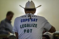 "Retired Bath Township Police Det. Howard ""Cowboy"" Wooldrige waits for election results to come in for Proposal 18-1 during the Coalition to Regulate Marijuana Like Alcohol public watch party at The Radisson in Lansing, Mich., on Tuesday, Nov. 6, 2018"