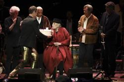Joni Mitchell is presented with a birthday cake on stage at JONI 75: A Birthday Celebration on Wednesday, Nov. 7, 2018, at the Dorothy Chandler Pavilion in Los Angeles.