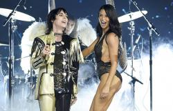 Adriana Lima, right, walks the runway as Luke Spiller of The Struts performs during the 2018 Victoria's Secret Fashion Show at Pier 94.