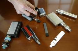 A high school principal displays vaping devices that were confiscated from students.