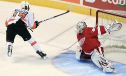 In this Sept. 22, 2011, file photo, Philadelphia Flyers' Wayne Simmonds scores on Detroit Red Wings goalie Jordan Pearce during the shootout of a preseason NHL hockey game in London, Ontario
