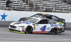 In this Sunday, Nov. 4, 2018, file photo, Kevin Harvick (4) passes David Starr (97) during the NASCAR Cup auto race at Texas Motor Speedway in Fort Worth, Texas
