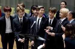 Members of the Korean K-Pop group BTS attend a meeting at the U.N.