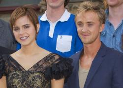 Emma Watson and Tom Felton pose at St Pancras Renaissance Hotel in central London.
