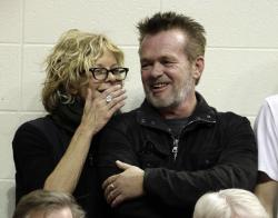 Meg Ryan, left, talks with performer John Mellencamp