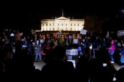 "Protesters gather in front of the White House in Washington, Thursday, Nov. 8, 2018, as part of a nationwide ""Protect Mueller"" campaign."