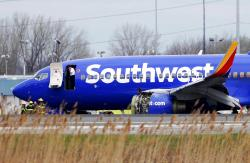 A Southwest Airlines plane sits on the runway at the Philadelphia International Airport in Philadelphia, PA.