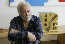 Artist Robert Indiana poses at his studio in Vinalhaven, Maine.