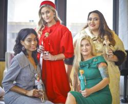 Designer Katie Echeverry, second from right, join models Tiffany Hendrix, far left, Kelsey Elliott, second from left, and Lori Moran, far right, wearing outfits from a Barbie inspired fashion line.