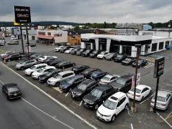 In this Sept. 2, 2018, file photo new vehicles are displayed for sale at a Buick GMC dealership in Union, N.J.
