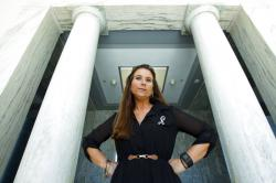 Jamee Cook poses for a photo at Rayburn House Office Building after meeting with congressional leaders on Capitol Hill.
