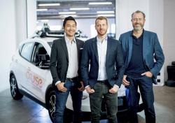 In this Nov. 20, 2018, photo provided by General Motors/Cruise, from left, Cruise Automation's Dan Kan and Kyle Vogt pose for a photo with General Motors' Dan Ammann at Cruise Automation offices in San Francisco, Calif.