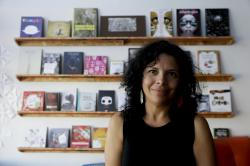 In this Saturday, Nov. 3, 2018, photo, Celene Navarette poses for a picture at La Libreria book store in Los Angeles